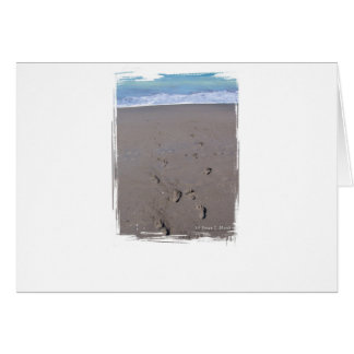 Footprints in beach sand blue ocean in back cards