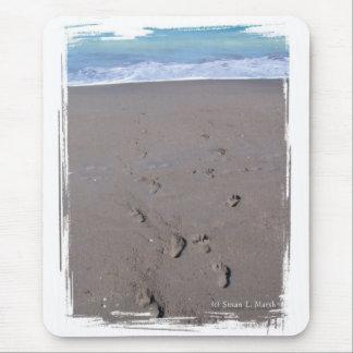 Footprints in beach sand blue ocean in back mousepad