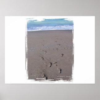Footprints in beach sand blue ocean in back poster