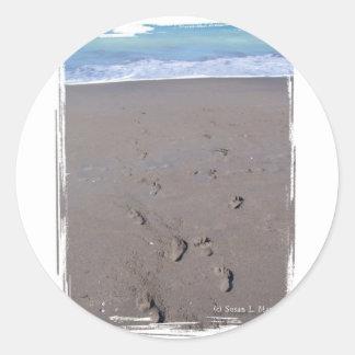 Footprints in beach sand blue ocean in back sticker