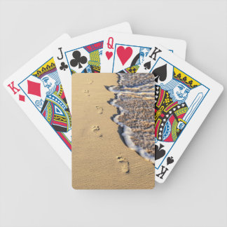 Footprints in sand on beach bicycle poker cards