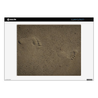 Footprints of Innocence in the Sand Skin For Laptop
