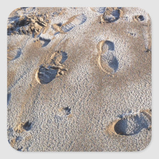 Footprints on beach in sand square sticker