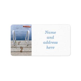 Footprints on dock at summer lake label
