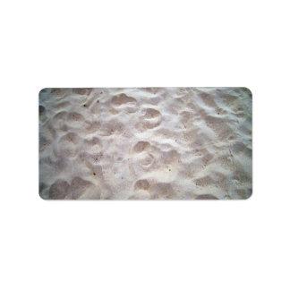 Footprints on sand texture address label