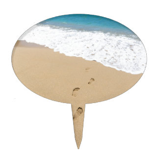 Footsteps in sandy beach leading to blue sea cake topper