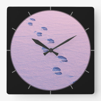 Footsteps on snow square wall clock