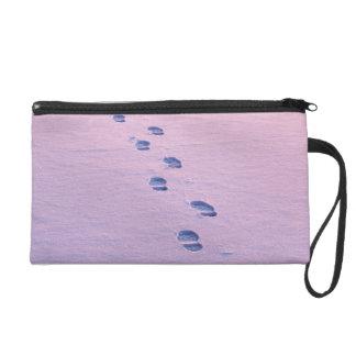Footsteps on snow wristlet purse