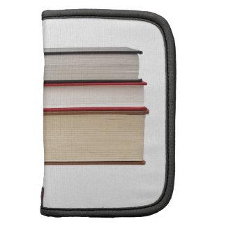 Fore edge of three books folio planner