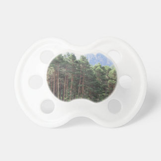 Forest landscape with mountain background pacifier
