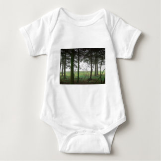 Forest overlooking clearing in the fog baby bodysuit