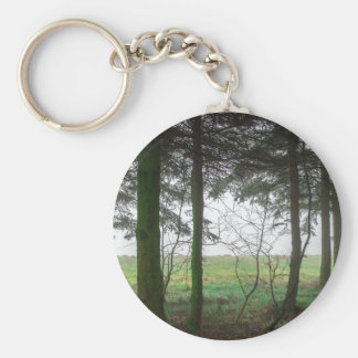 Forest overlooking clearing in the fog keychain