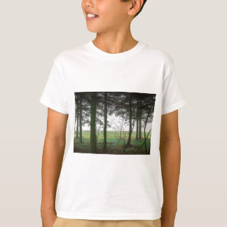 Forest overlooking clearing in the fog T-Shirt