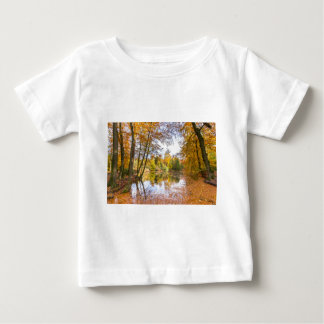 Forest pond covered with leaves of beech trees baby T-Shirt