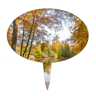 Forest pond covered with leaves of beech trees cake topper