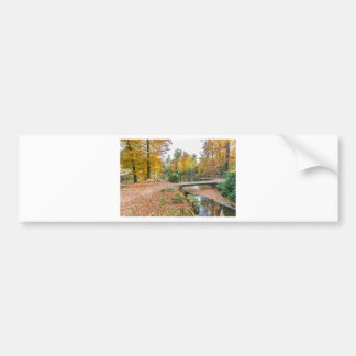 Forest with pond and bridge in fall colours bumper sticker