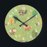 """Forest Woodland Animal Pattern Kids Room Decor Round Clock<br><div class=""""desc"""">Decorate the kids or nursery room with this cute woodland animal themed pattern design!. This cute, cheerful and colourful pattern is made using a variety of woodland animals which include bird, deer, fox, a hopping bunny, a squirrel with acorn nut, a raccoon and a hedgehog. Decorated with trees, white daisies,...</div>"""