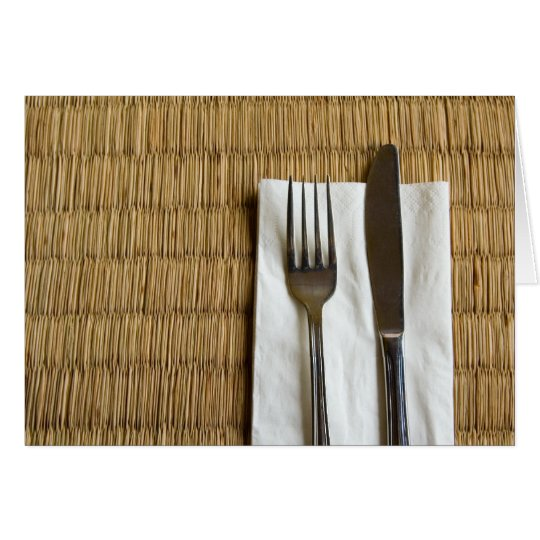 Fork and knife on a dried grass mat card