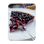 Fork slicing blueberry pie on plate rectangle magnet