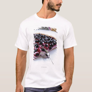 Fork slicing blueberry pie on plate T-Shirt