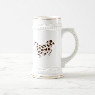 Forma de la vaca con las manchas marrones tazas de café