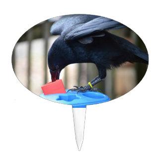 forma negra del cuervo que clasifica el juguete de figura de tarta