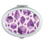 Formas geométricas púrpuras de la joya espejos de maquillaje