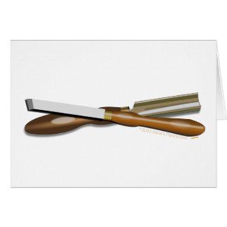 Formón cruzado herramientas y posición oblicua del tarjeta de felicitación