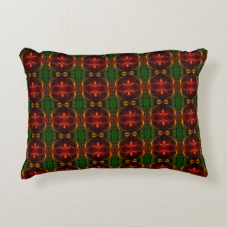 """Forms, """"red traces float"""", in green fund accent pillow"""
