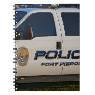 fort pierce police department pickup truck closeup spiral note book