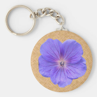 Foto azul del geranio de la flor llavero redondo tipo pin