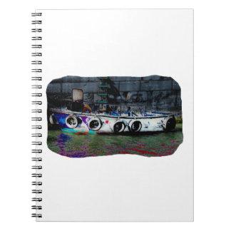 Foto coloreada única del bote pequeño notebook
