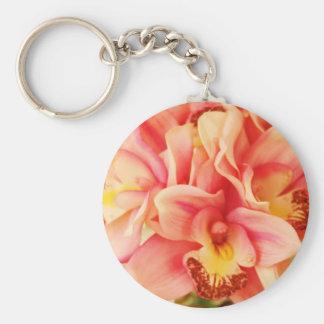 Foto de la orquídea del rosa y del melocotón llaveros