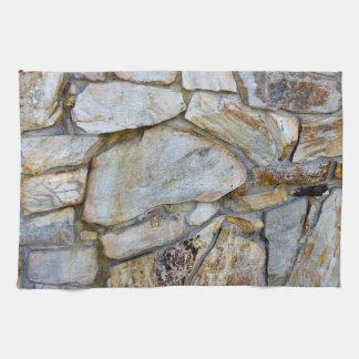 Foto de la textura de la pared de la roca en la toallas de cocina