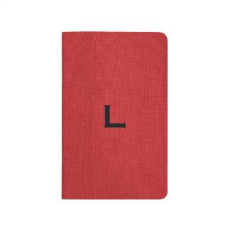Foto de lino roja de la textura con el monograma cuadernos grapados