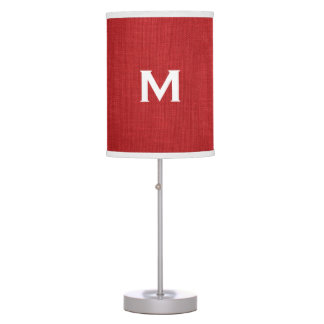 Foto de lino roja de la textura con el monograma lámpara de mesilla de noche