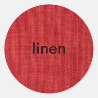 Foto de lino roja de la textura etiqueta redonda