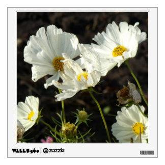 Foto de una cama de flor del blanco y de las