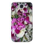 Foto del centro de flores púrpura y blanca