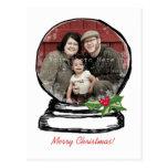 Foto del globo de la nieve del navidad postal