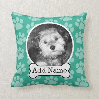Foto del mascota con verde de las impresiones del almohadas