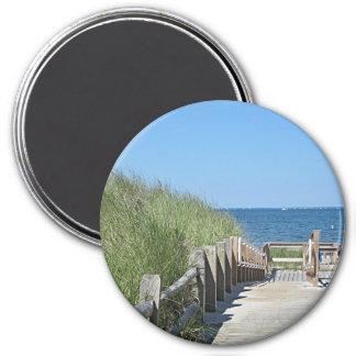 Foto del paseo marítimo de la playa imán redondo 7 cm