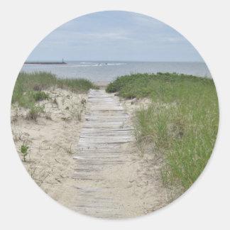 Foto del paseo marítimo de la playa pegatina redonda
