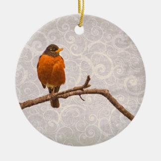 Foto del petirrojo con diseño del remolino del adorno redondo de cerámica