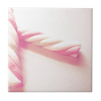 Foto dulce del caramelo de la torsión azulejos