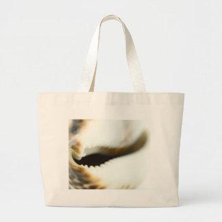 Foto macra de un Seashell Bolsas Lienzo