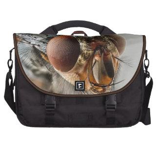 Foto macra de una mosca bolsas de ordenador