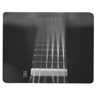 Foto negra de la guitarra acústica cuadernos