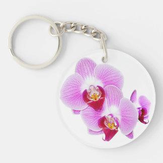 Foto radiante del primer de la orquídea - aislada  llaveros