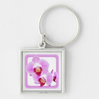 Foto radiante del primer de la orquídea con el mar llavero personalizado
